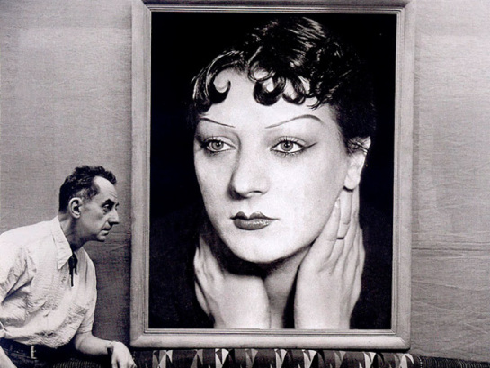 michel-sima-man-ray-in-front-of-a-portrait-of-kiki-de-montparnasse