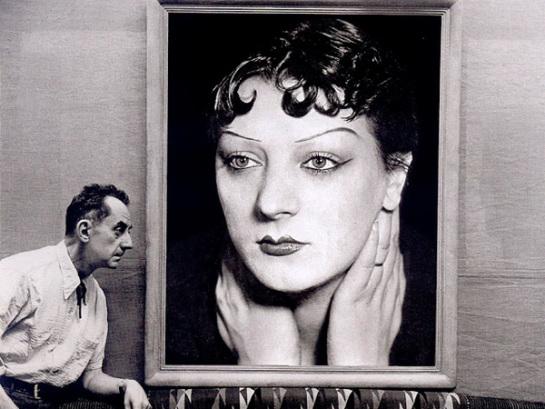 michel-sima-man-ray-in-front-of-a-portrait-of-kiki-de-montparnasse